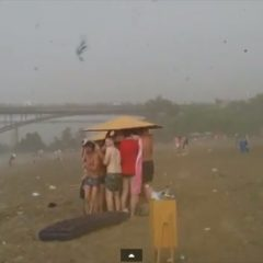 People Fleeing From Hail Storm